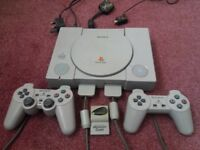 PS1 (Sony Playstation 1) console, controllers x 2, memory card and 8 games bundle