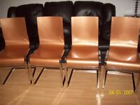 4 CHROMED SOLID STAINLESS STEEL FRAMED CHAIRS