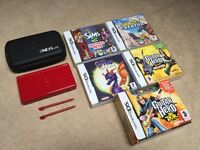 Red Nintendo DS with case, 5 games and guitar hero strap