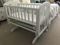 Upcycled white swinging crib.