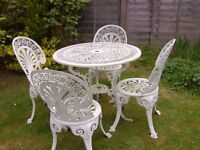 WHITE CAST IRON PATION TABLE AND FOUR CHAIRS