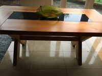Heavy solid wood chunky dining room table with glass insert