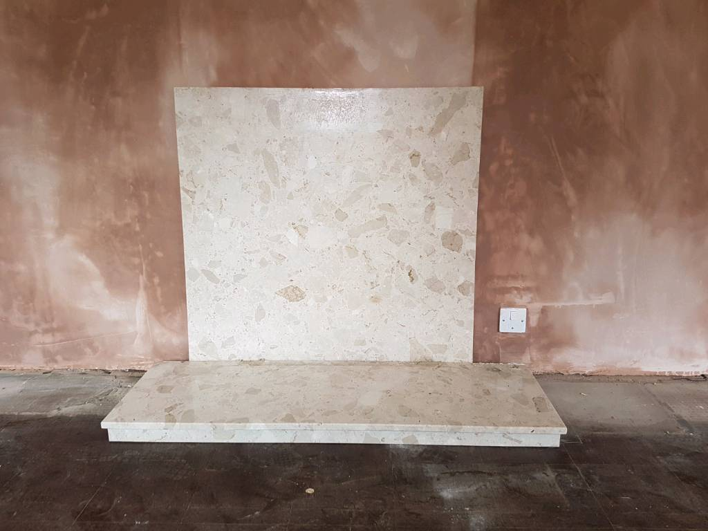 Marble hearth and fire surround.