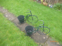 2 used tricycles metal planters repainted nice condition