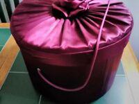 Red satin vintage hat box.