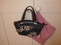 Small black Radley handbag with leaf applique design. original tags and dust bag