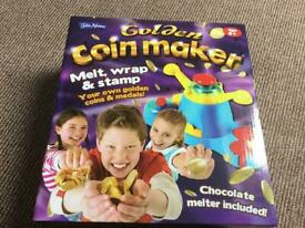 Chocolate coin maker.