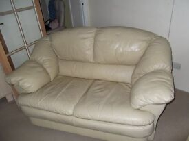 Cream 2 seater leather sofa.