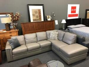 %50 Off Open Box Costco.ca Product at dex10. Top Grain Leather Pullout bed Sectional in Grey