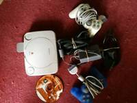***Reduced***Sony Playstation one with charger controls and game