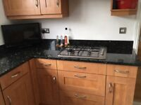 Kitchen units with granite worktop. Bosch dishwasher, fridge, gas hob, sink and taps included.