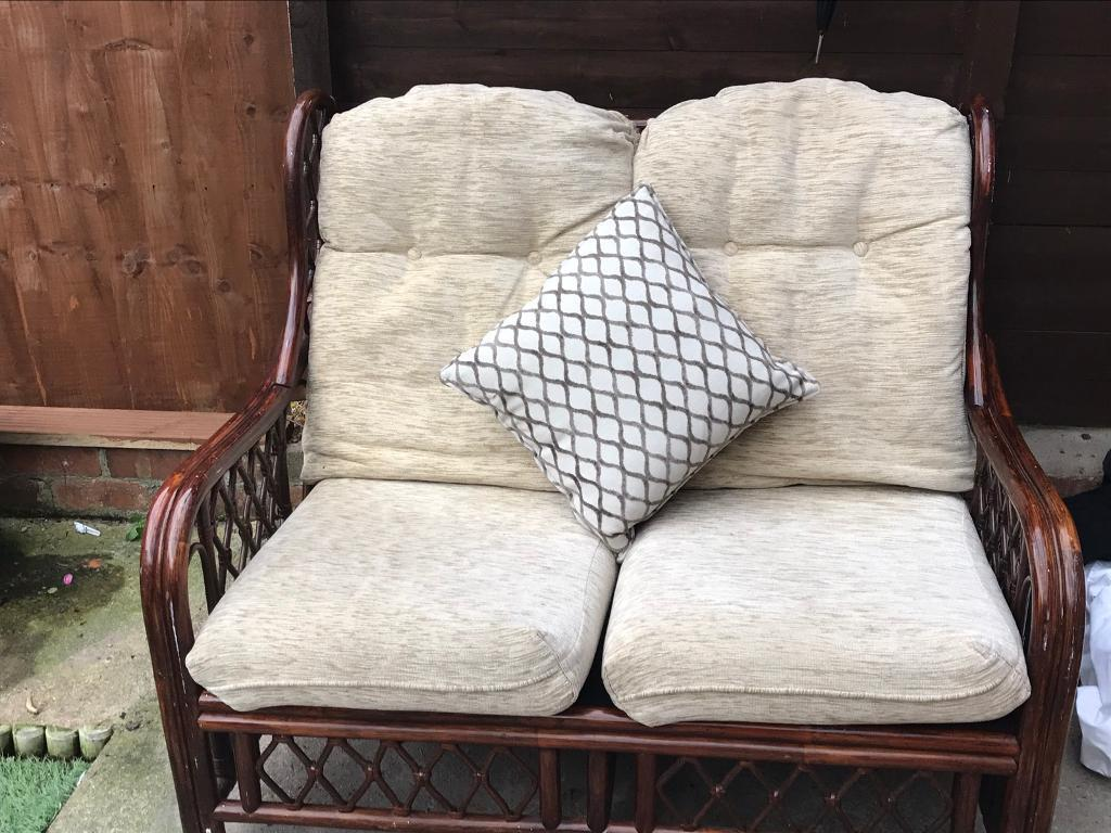 Dark cane conservatory sofa and two chairs