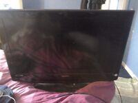 A flat screen tv made by technika 32inch