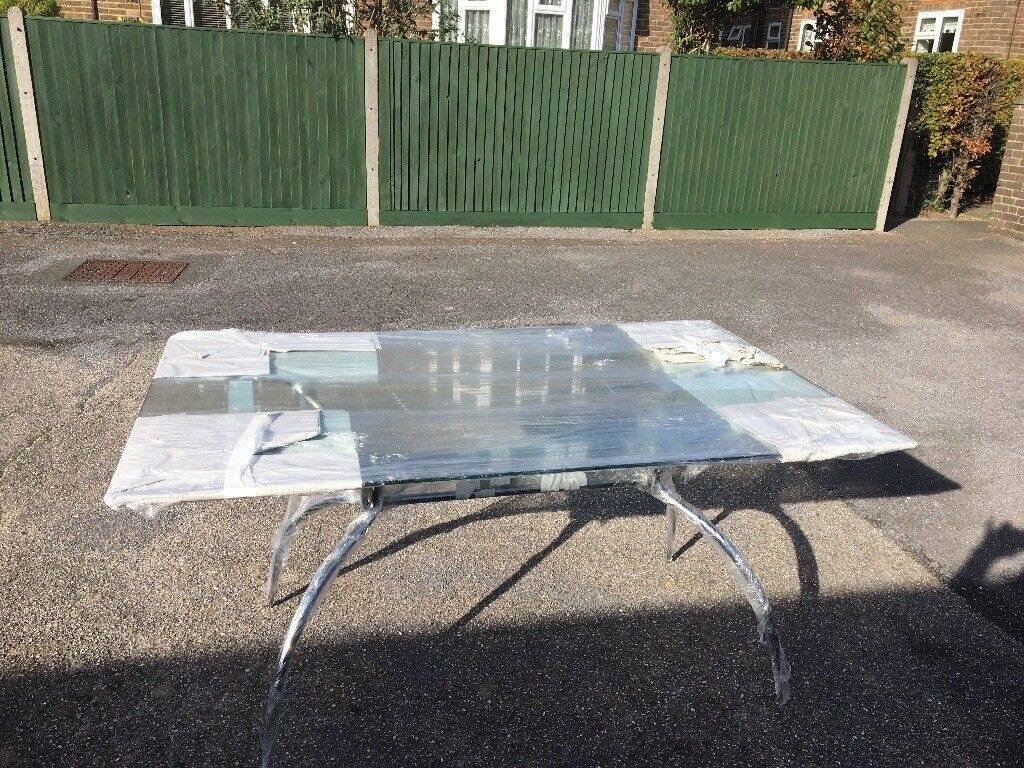 Glass and Chrome Dining Table.