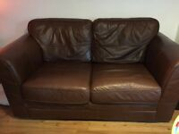 2x brown leather two seater sofas