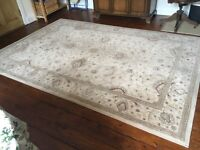 Large rug, mostly cream coloured , good condition