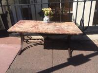 Marble table forged base