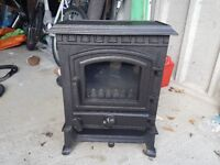 cast iron multi fuel stove. never been used, new. .