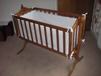 Swinging Crib. Hand crafted in richly coloured cherry wood. Broderie Anglais bumpers (hand made)