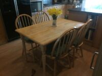 Good quality kitchen table & 4 chairs- made of rubber wood- light coloured hardwood.