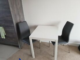 White Extendable Dinning Room table and two chairs