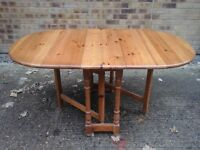 solid pine drop leaf table £45 + 2 pine chairs £15