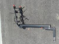 Trailer hitch bike carrier with ski/snowboard attachment.