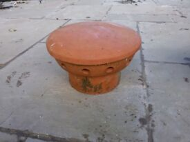 Two terracotta chimney cowls, good as new.