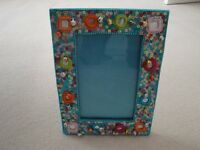 GIRL'S BRIGHT AQUA PHOTO FRAME. BEADS, SEQUINS AND EMBROIDERY