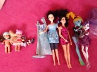 Monster high and barbie dolls and accessories