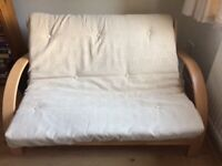 Wooden Futon with double mattress for sale.
