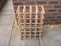 A 24 bottle holding wood and metal wine rack.