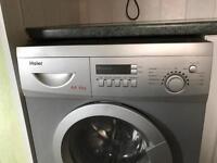 Silver Haier washing machine