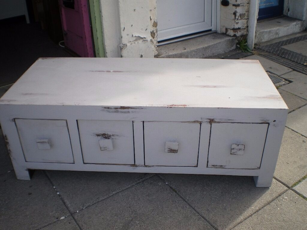 SOLID WOOD COFFEE TABLE WITH DRAWERSin Poole, DorsetGumtree - SOLID WOOD COFFEE TABLE,VERY STURDY AND SOLID CONSTRUCTION,HAS FOUR VERY DEEP DRAWERS WHICH OPEN OUT BOTH WAYS,PAINTED IN FRENCH GREY IN A DISTRESSED LOOK,COULD ALSO BE USED FOR THE BIGGEST TV