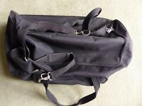 Strong TCM black canvas holdall with wheels; suit holiday or sports equipment. Excellent condition