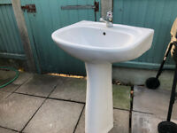 Used bathroom sink and pedestal including mixer tap