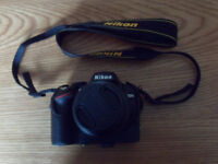 Nikon D3200 camera body with Nikon 18-55mm zoom lens and Nikon 55-200mm lens