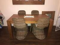 Baker and stone house table with 4 wicker chairs