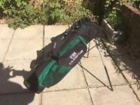 Kid's golf bag and six golf clubs