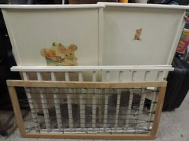 Second hand baby cot with mattress. Painted white with baby motif on end panels.