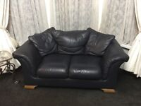 2 x 2 seater sofa and 1 x 3 seater leather sofa in dark blue. Good condition and very comfortable