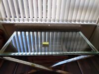Chrome and Glass coffee table plus side table. TK Max. Six months old.
