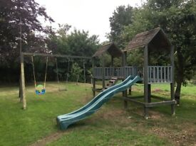 Wooden climbing frame, large with slide, 2 swings & rope good condition, will dismantle