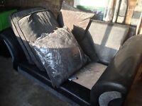 DFS dark grey 2 seater cushion back sofa