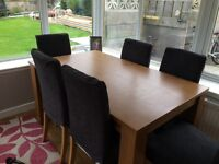 Lovely Oak Effect extending table and six chairs