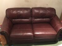 3 piece leather suite consisting of a sofa and 2 armchairs.