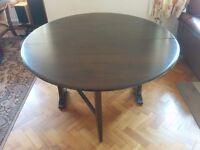 Ercol Drop-Leaf Dining Table in dark wood