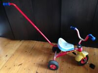 PLASTIC TRICYCLE: Learn how to peddle!