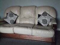 cream leather 3 seater & 2 seater suite,solid construction,very heavy,solid wood frame.