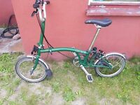 brompton racing bike almost new ,green colour , free pump , free lights